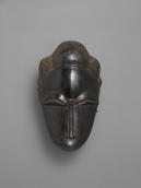 Unidentified Baule artist, Portrait Mask of a Woman (Ndoma), early 20th century. Wood and metal. Yale University Art Gallery, Purchased with a gift from Steven M. Kossak, B.A. 1972, and with the Leonard C. Hanna, Jr., Class of 1913, Fund