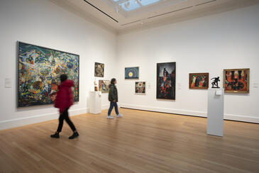 Visitors look at artworks in the Modern and Contemporary Art galleries.